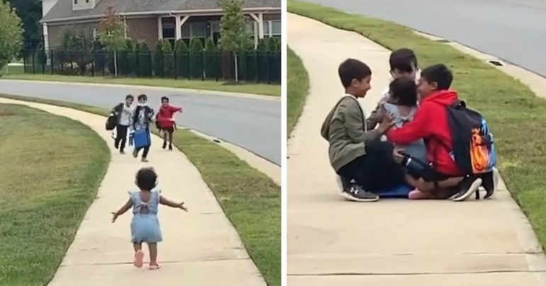 little girl greets brothers after school