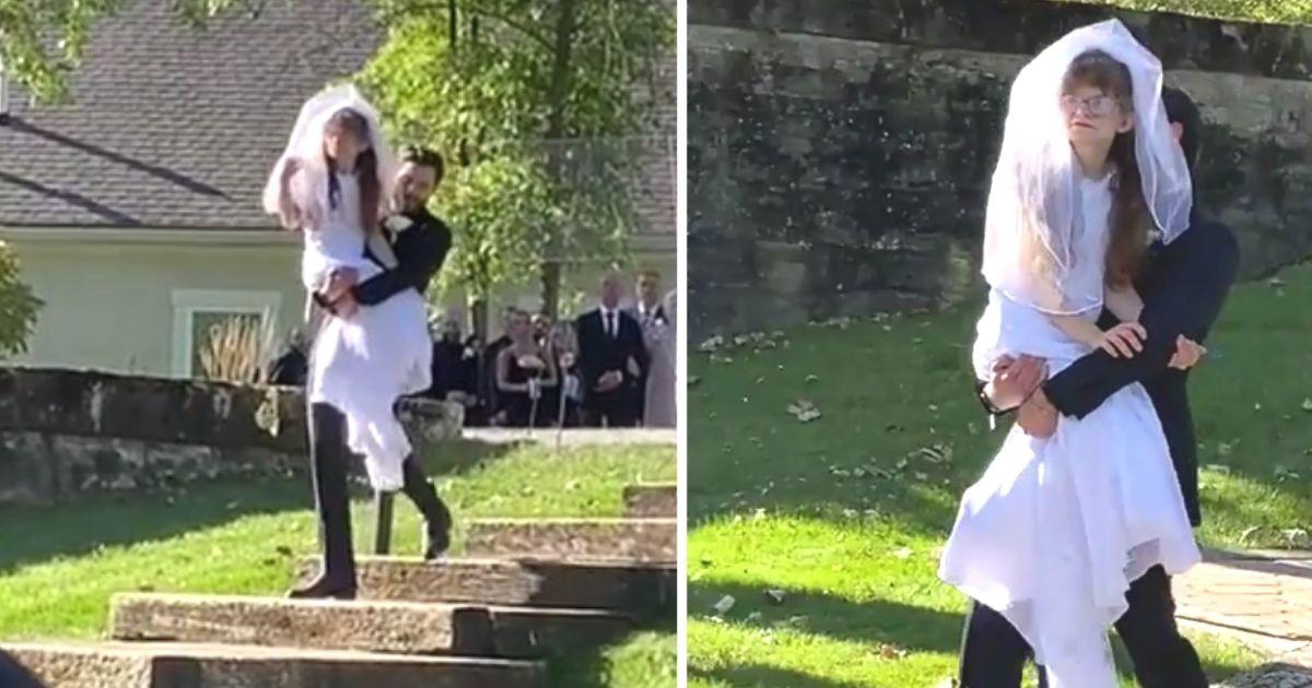 groom carries bride's sister