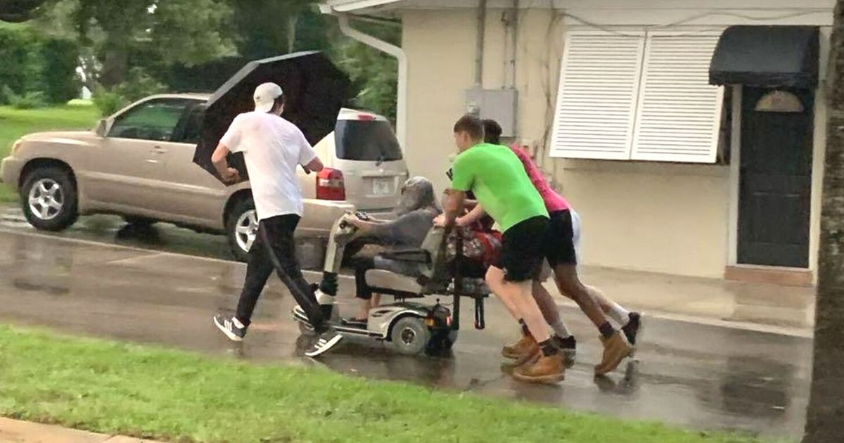 men push elderly woman