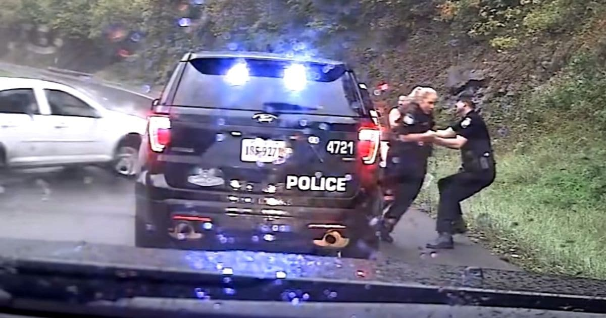 officer saves colleague from oncoming car