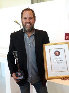 Fleur du Cap winemaker, Pieter Badenhorst with Top 10 Pinotage trophy