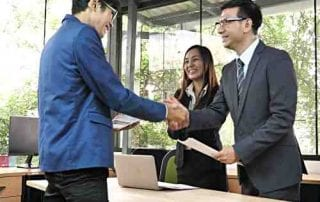 Asian Business people agreement a Business project, Handshak