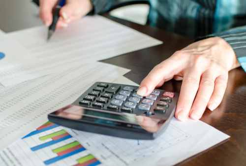 Female accountant checking financial documents at office
