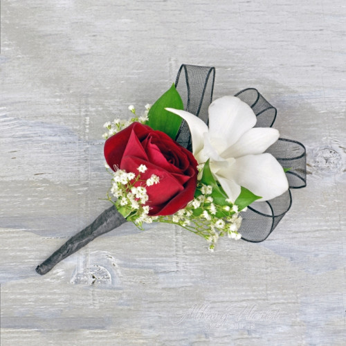 Boutonniere of white orchid and a rose