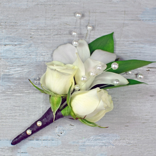 White roses and orchid boutonniere