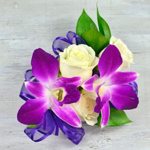 Purple and white wrist corsage