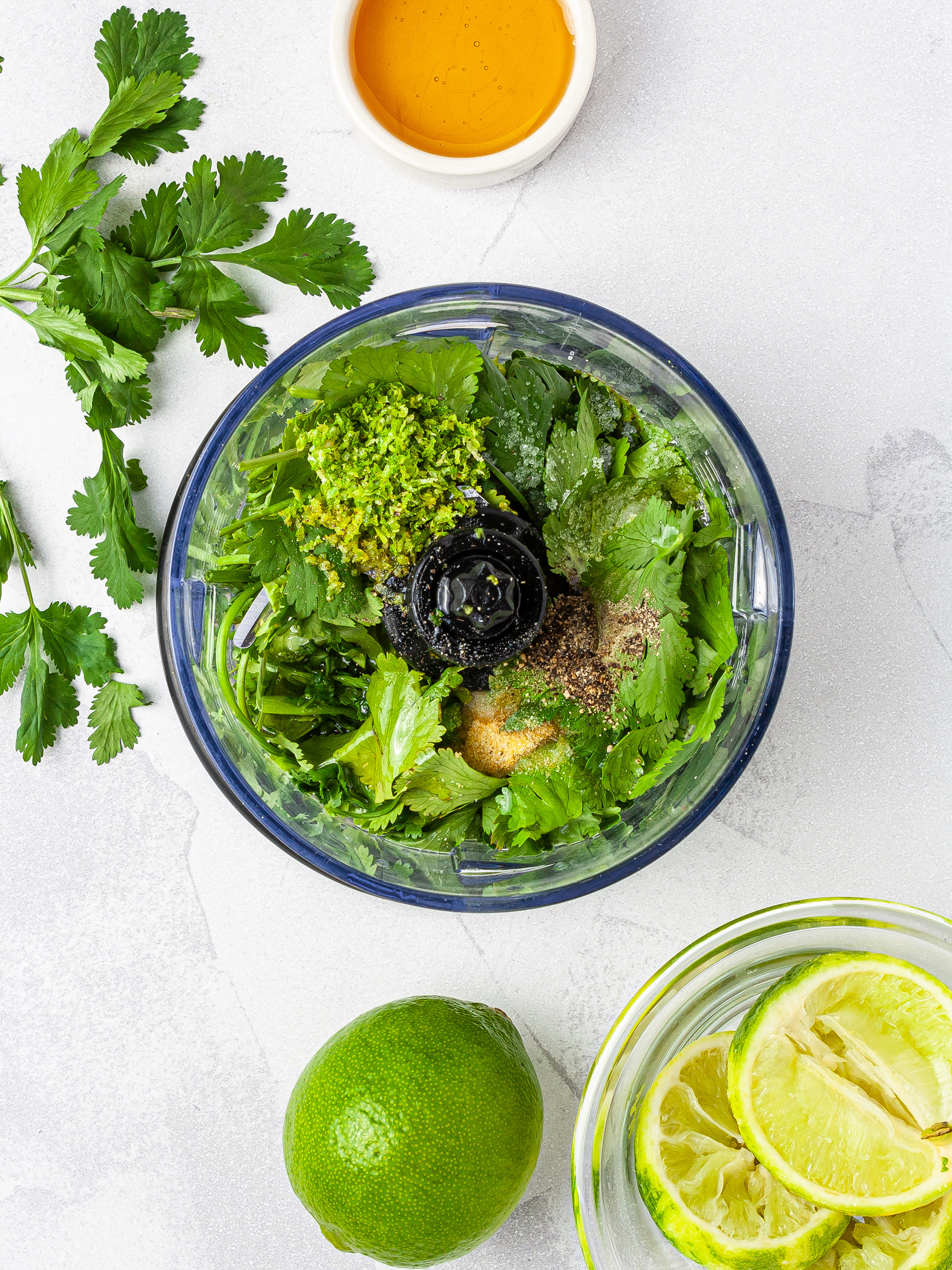 Cilantro, lime, and honey in a food processor to prepare the dressing.