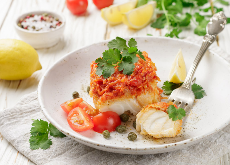 Monkfish with tomato and garlic sauce