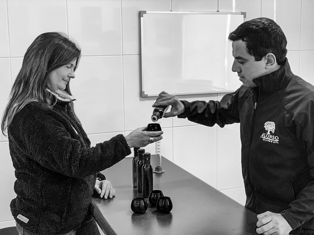 Juan Francisco González and Denise Langevin tasting fresh-pressed olive oil