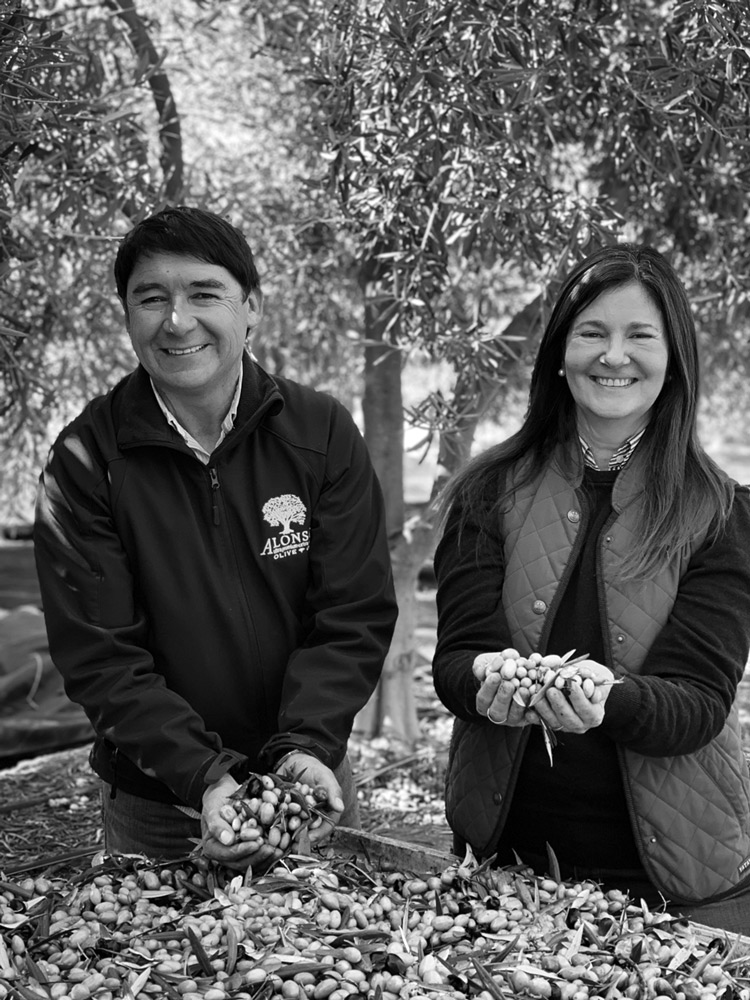 Juan Carlos Pérez and Denise Langevin with fresh-picked olives in Chile