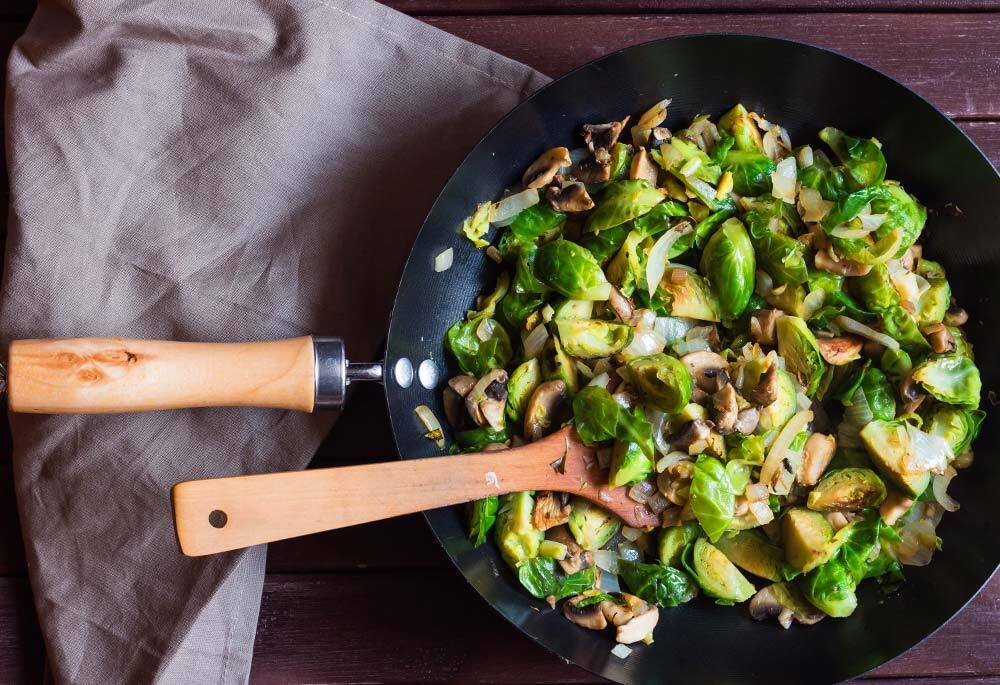 Roasted Brussels Sprouts and Onions with Mushroom Lardons