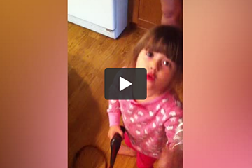 Little Girl Practices Her Makeup Skills on Her Dog