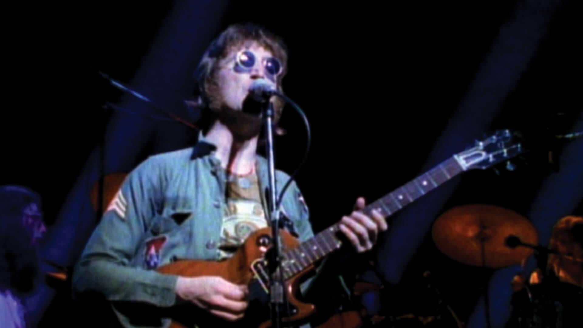 john lennon playing guitar and singing