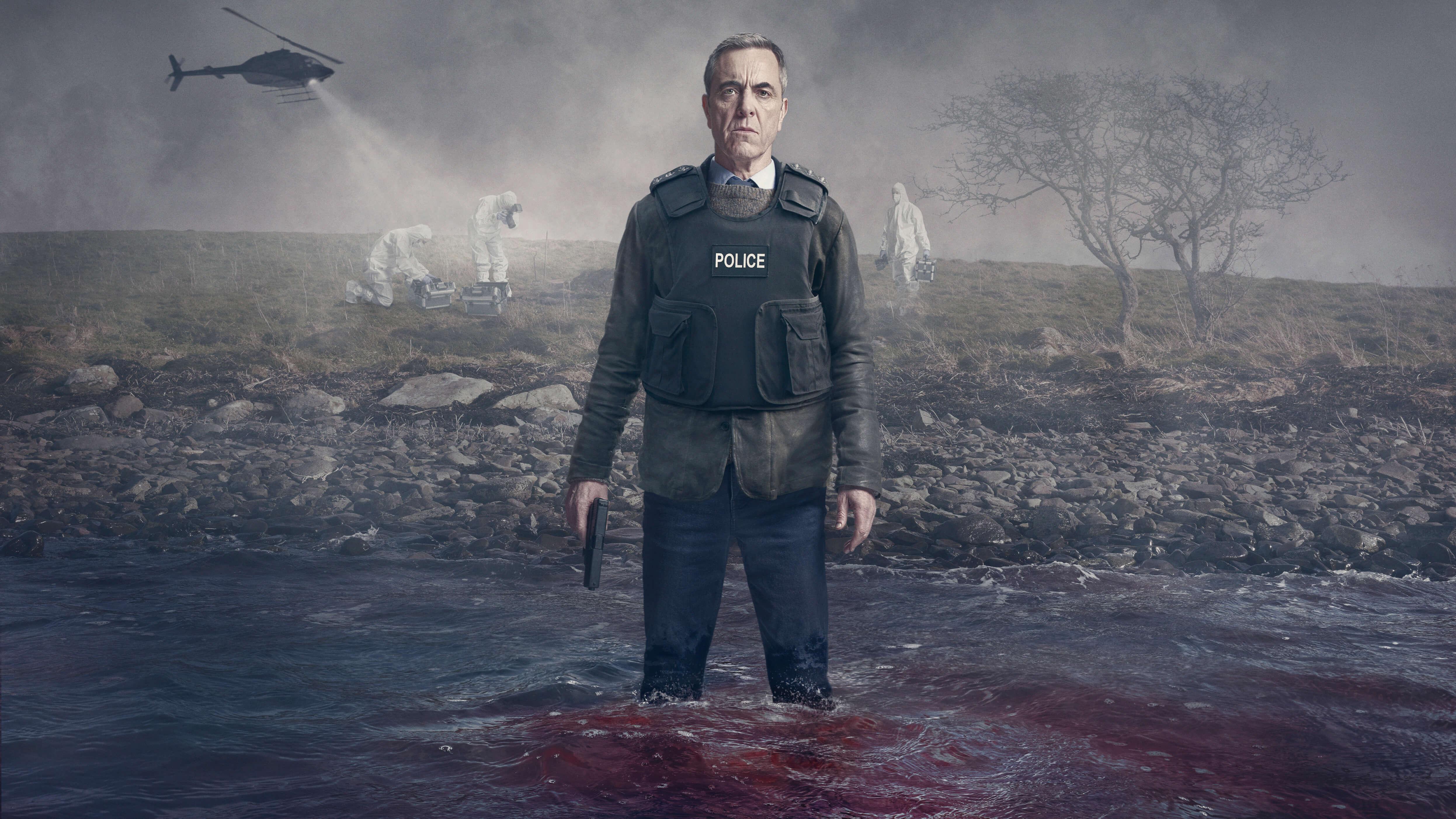 james nesbitt in police uniform holding a gun