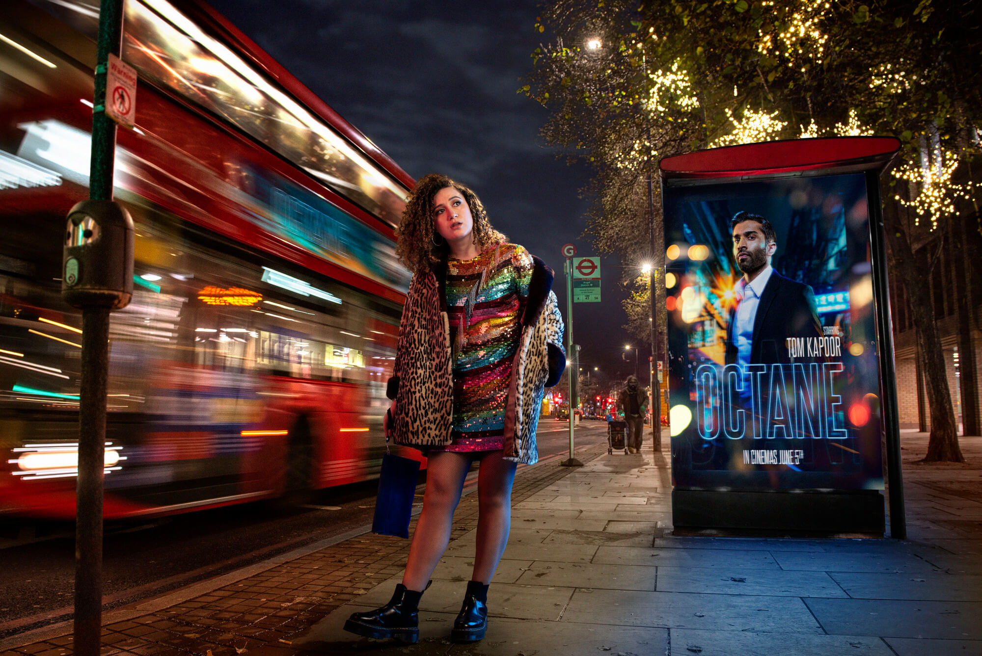 Rose Matafeo in sparkly dress at night with bus and film poster