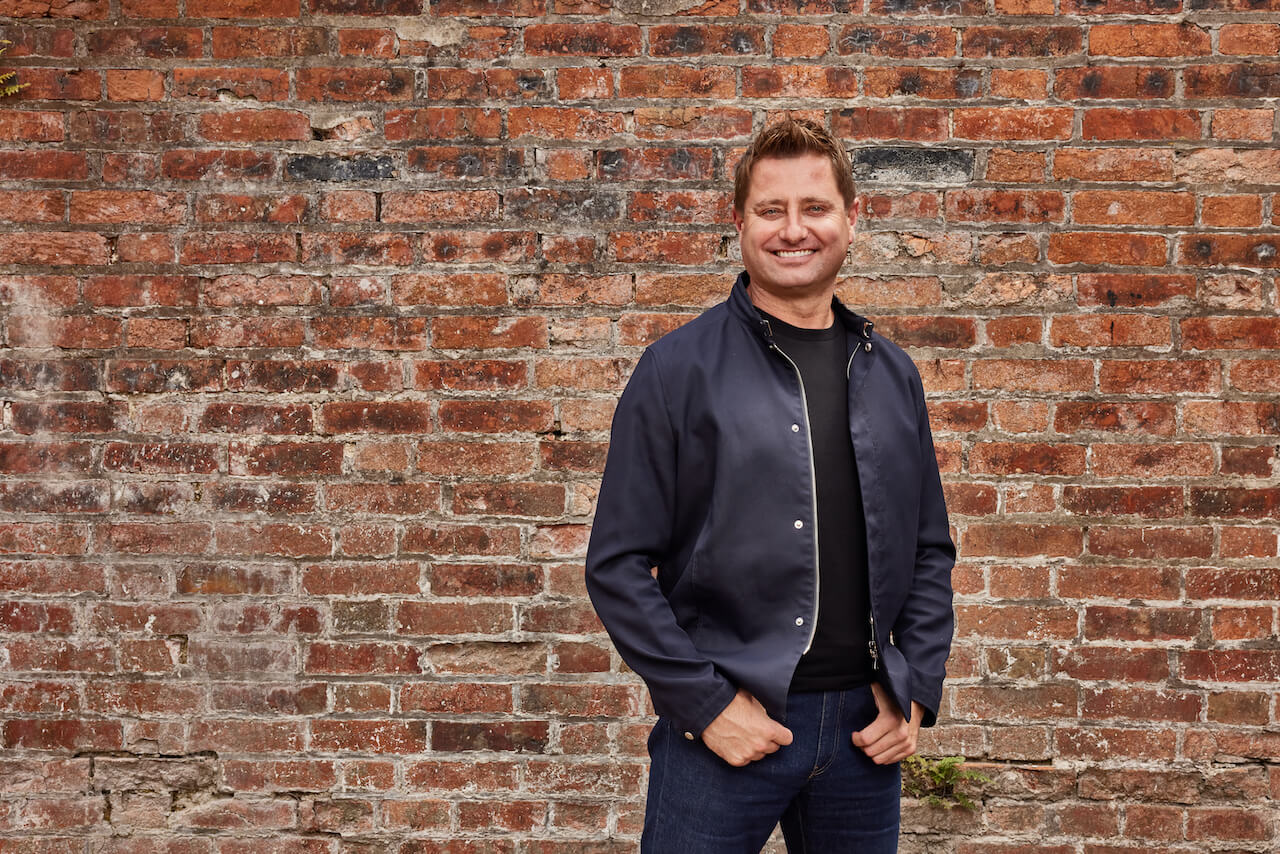 george clarke against red brick wall