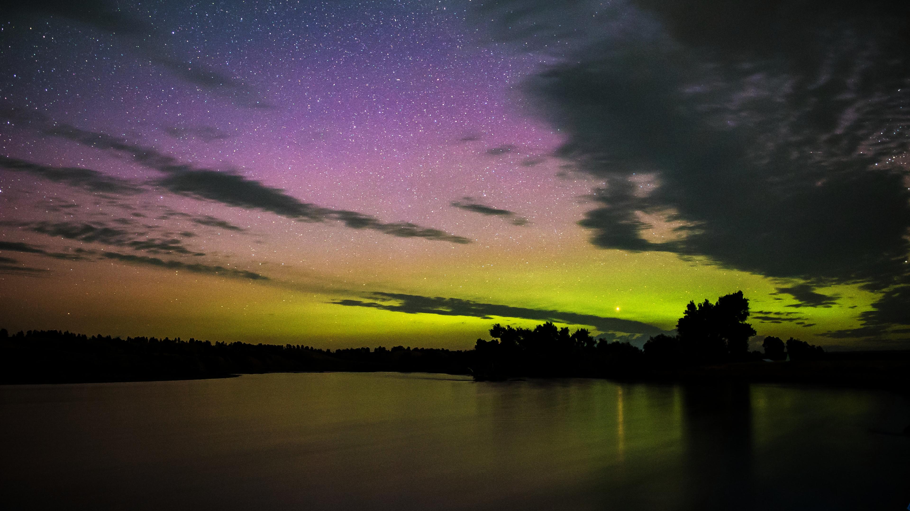 aurora borealis over yellowstone river