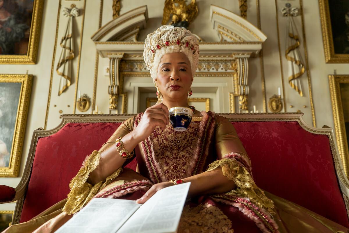 queen in bridgerton drinking tea