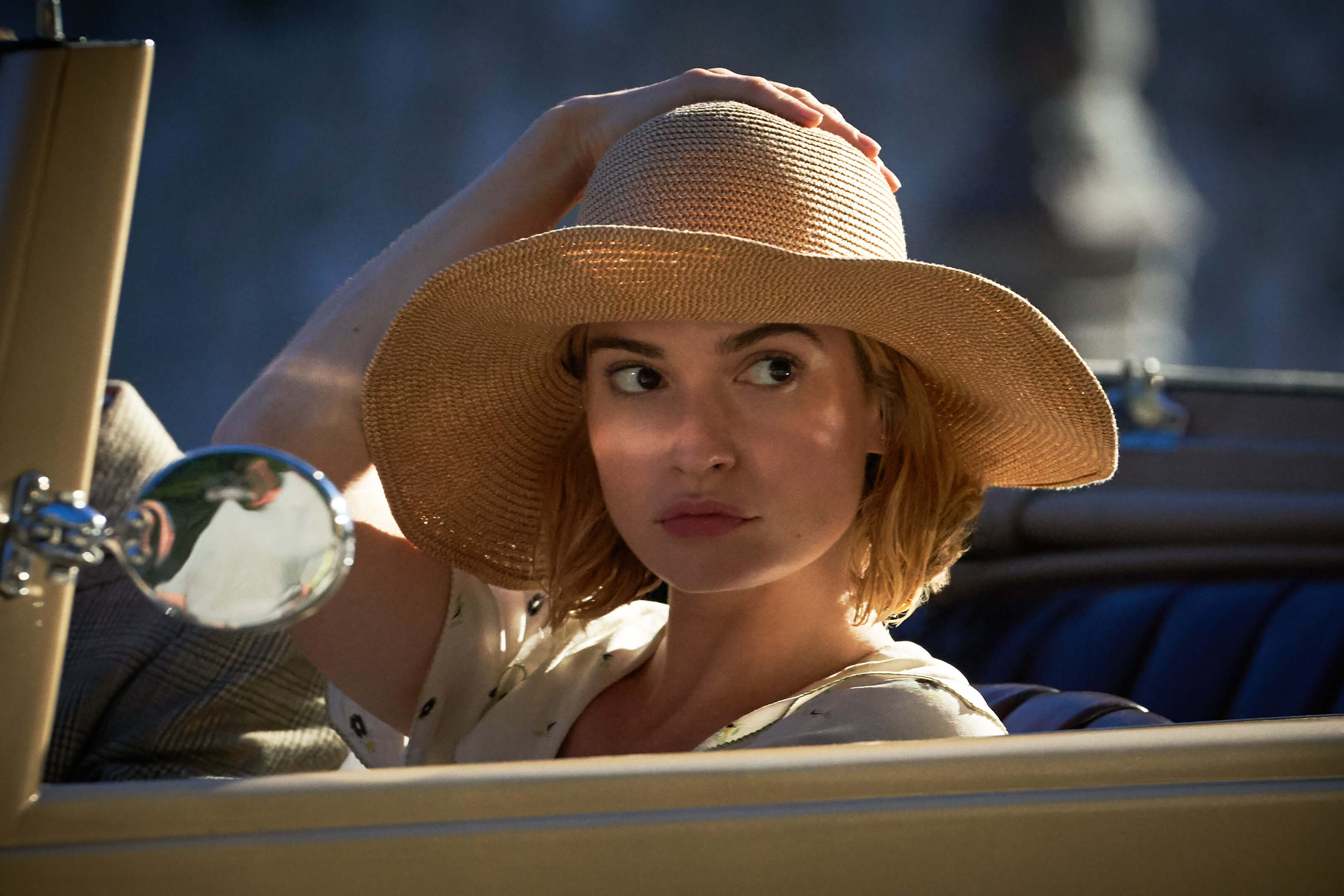 lily james in sunhat in rebecca