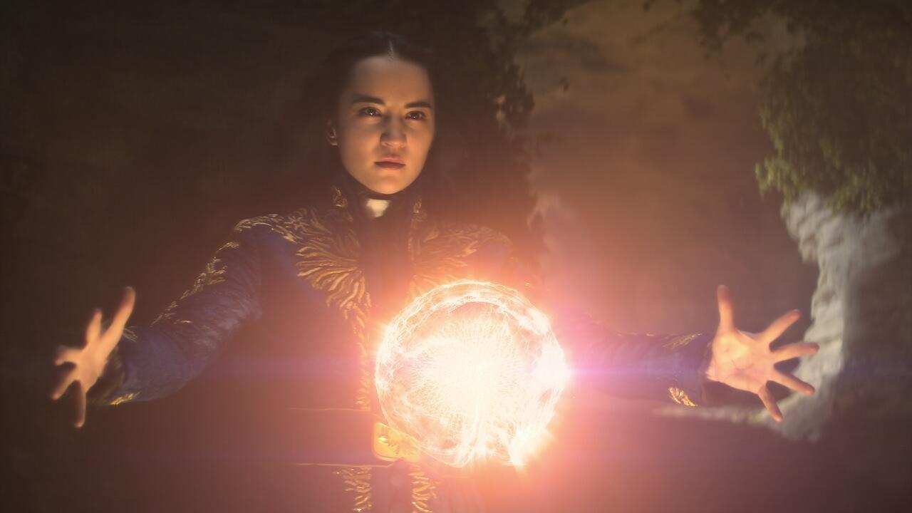 girl with glowing magic orb