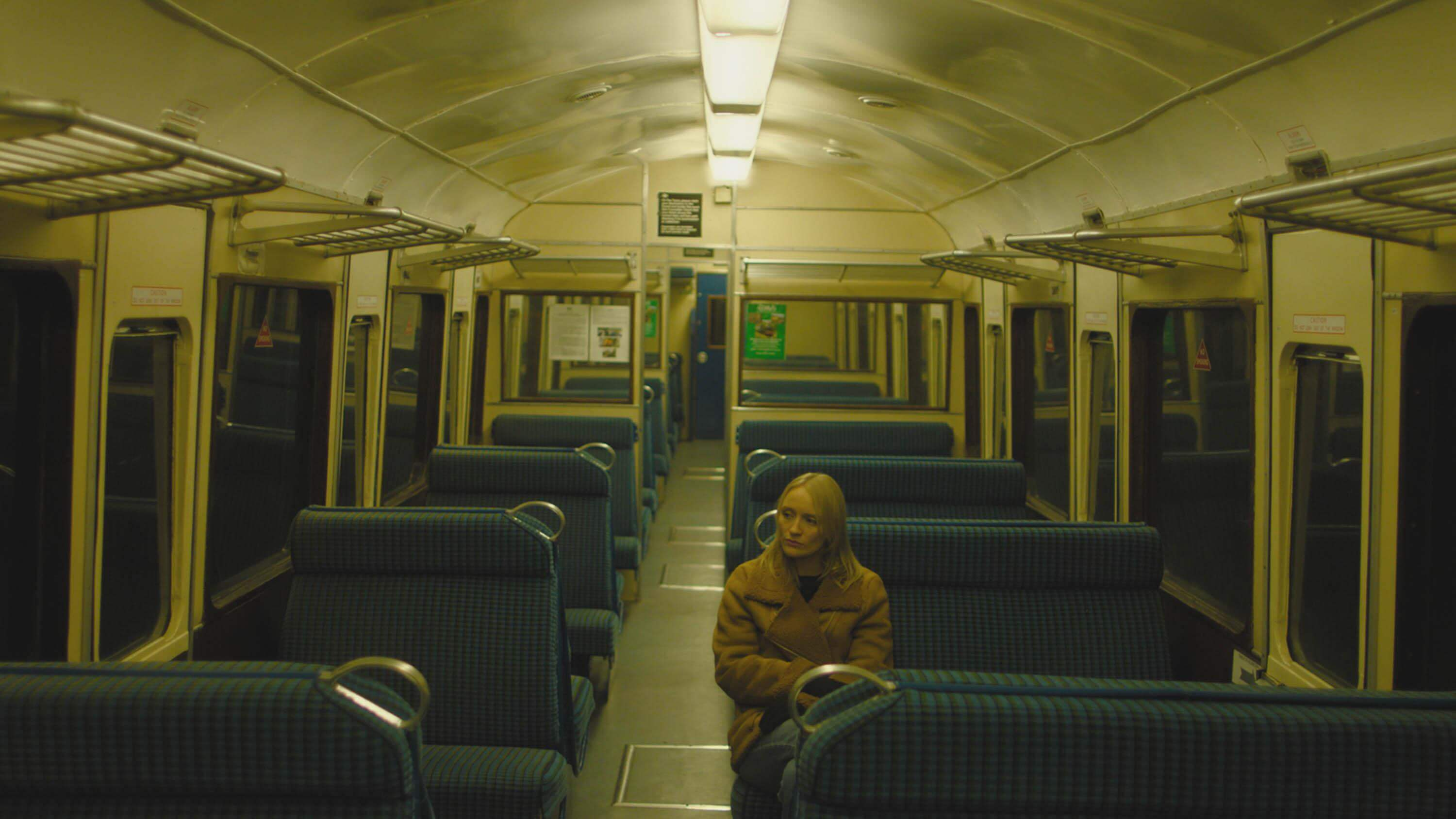 woman sat alone in a railway carriage