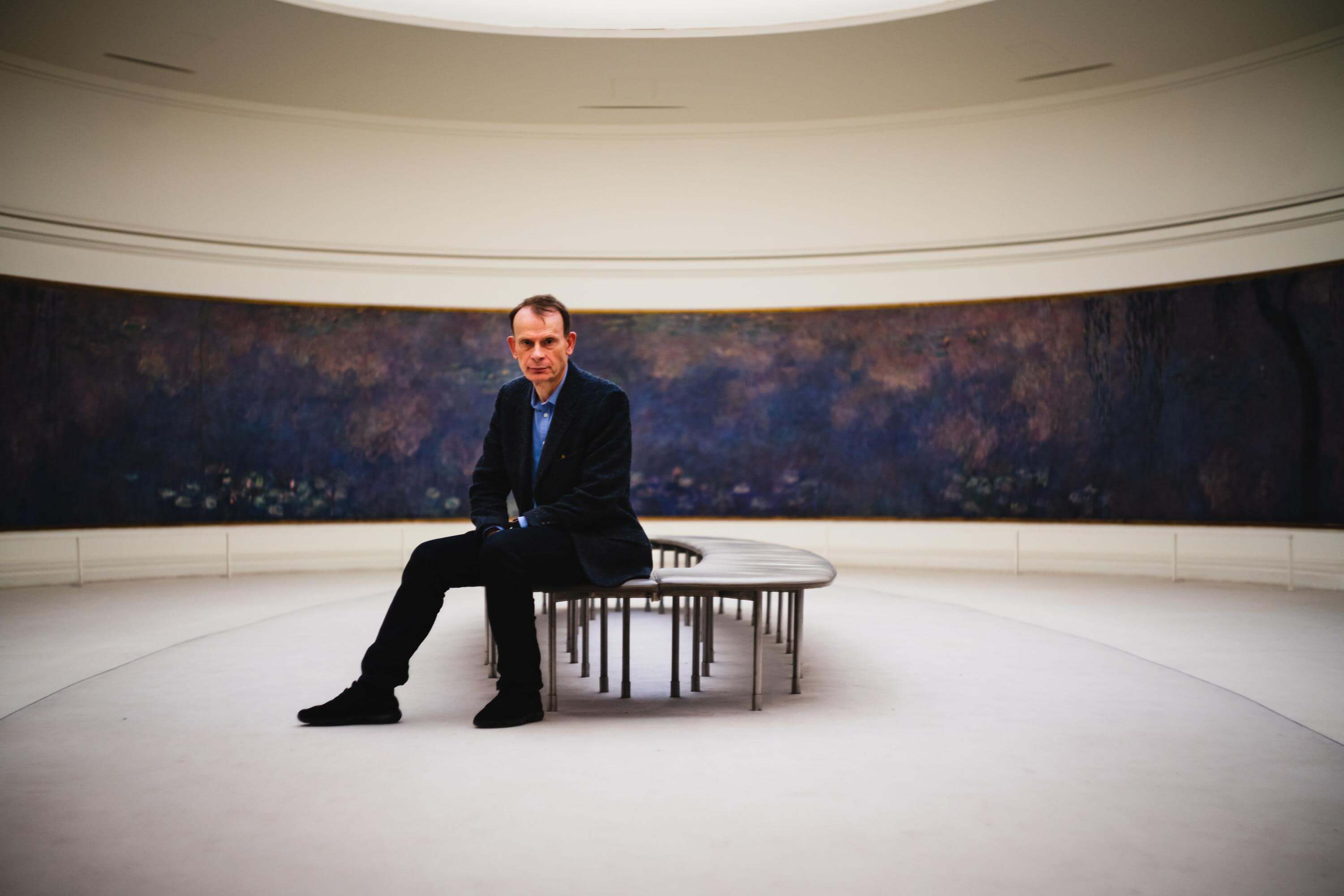 andrew marr sat in a gallery