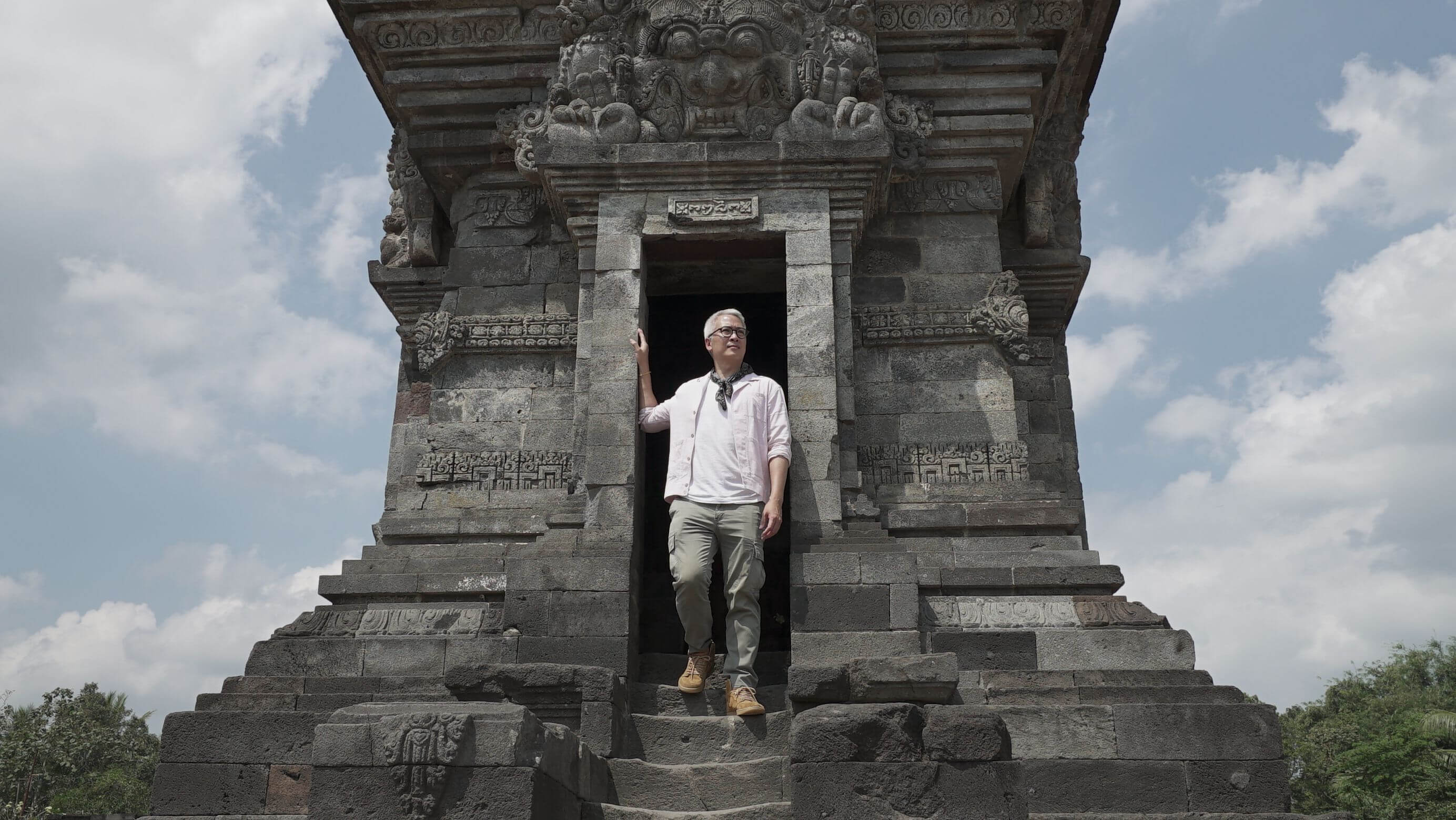 peter lee standing in ancient asian ruins
