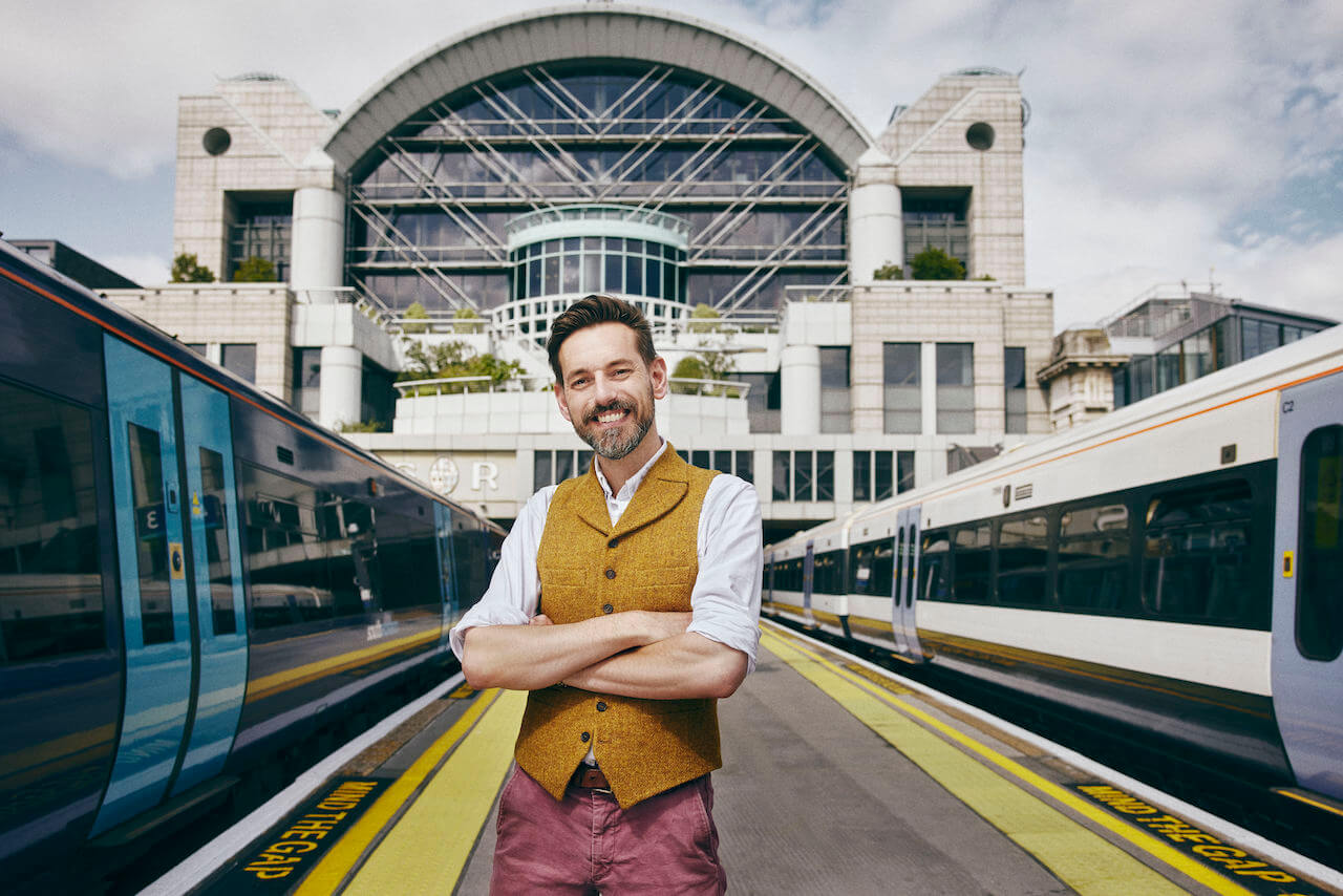 Tim Dunn in front of trains