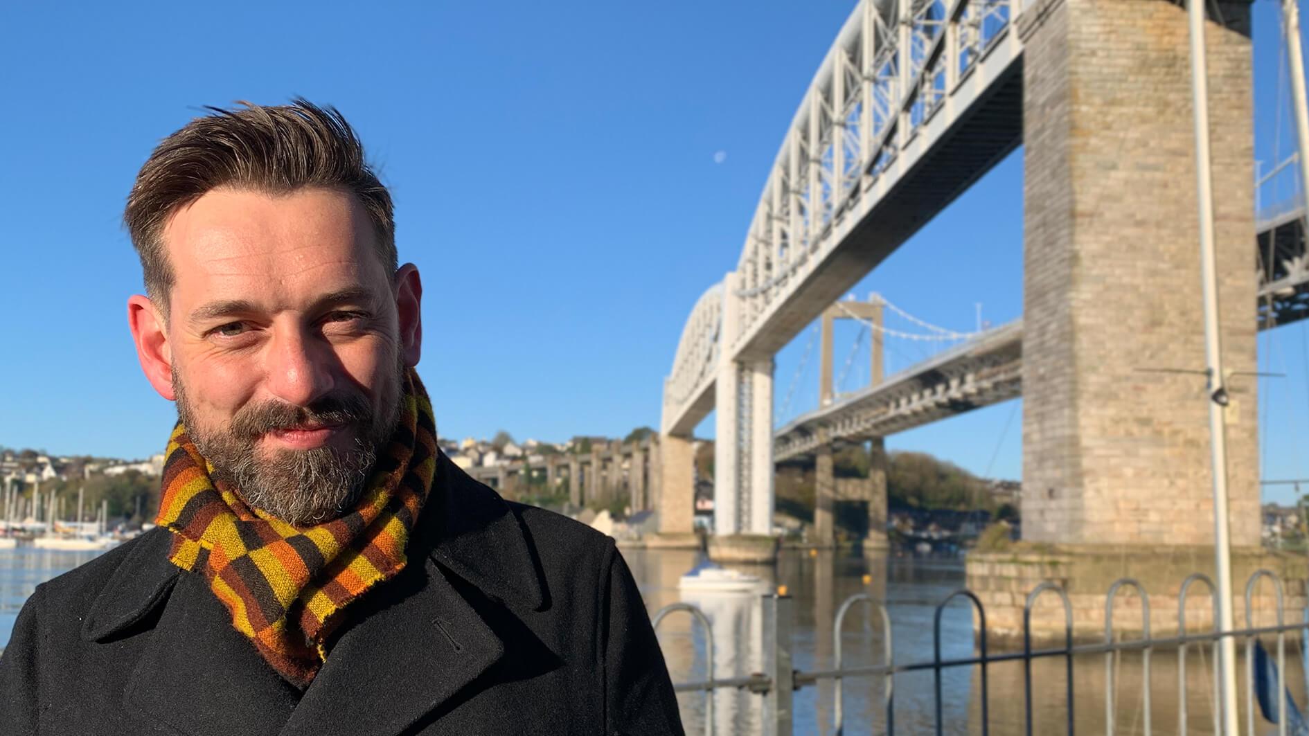 Tim Dunn in front of railway bridge