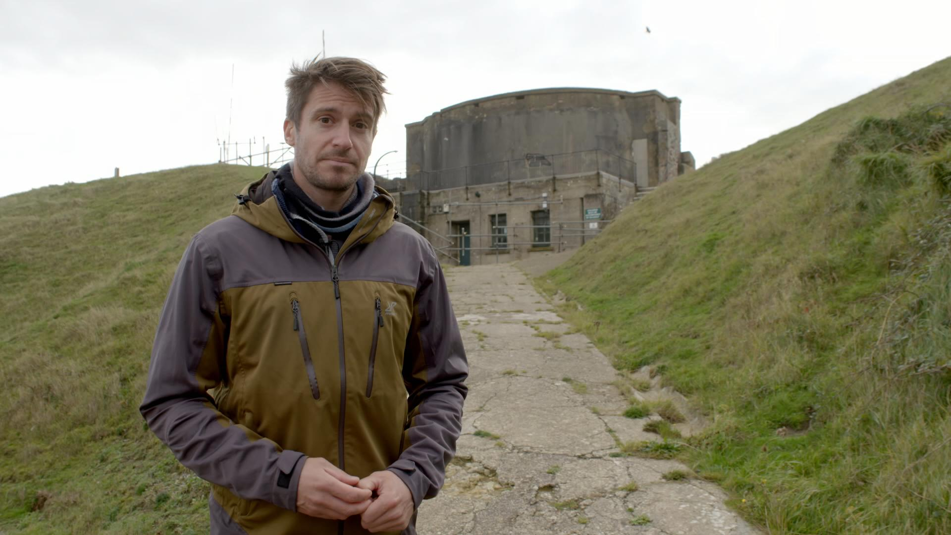 rob bell in front of ruined war building