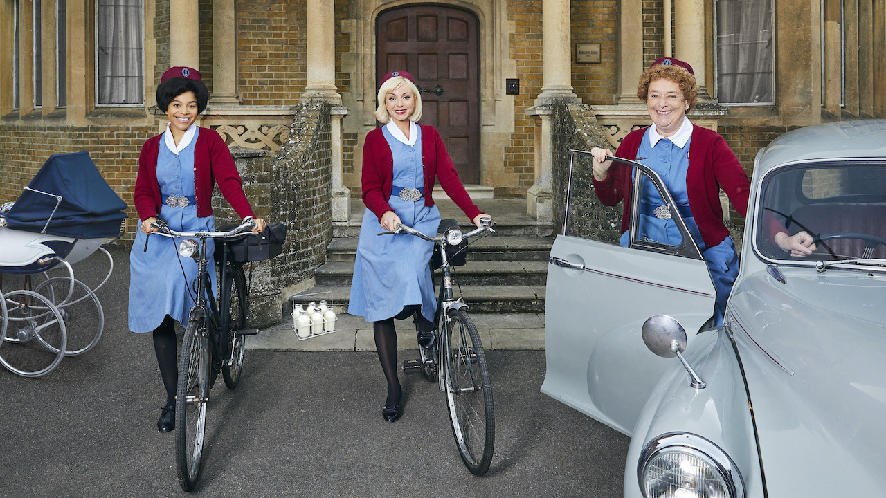 Three midwives on old fashioned bicycles