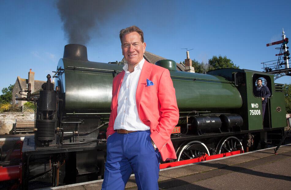 Michael Portillo in front of steam train