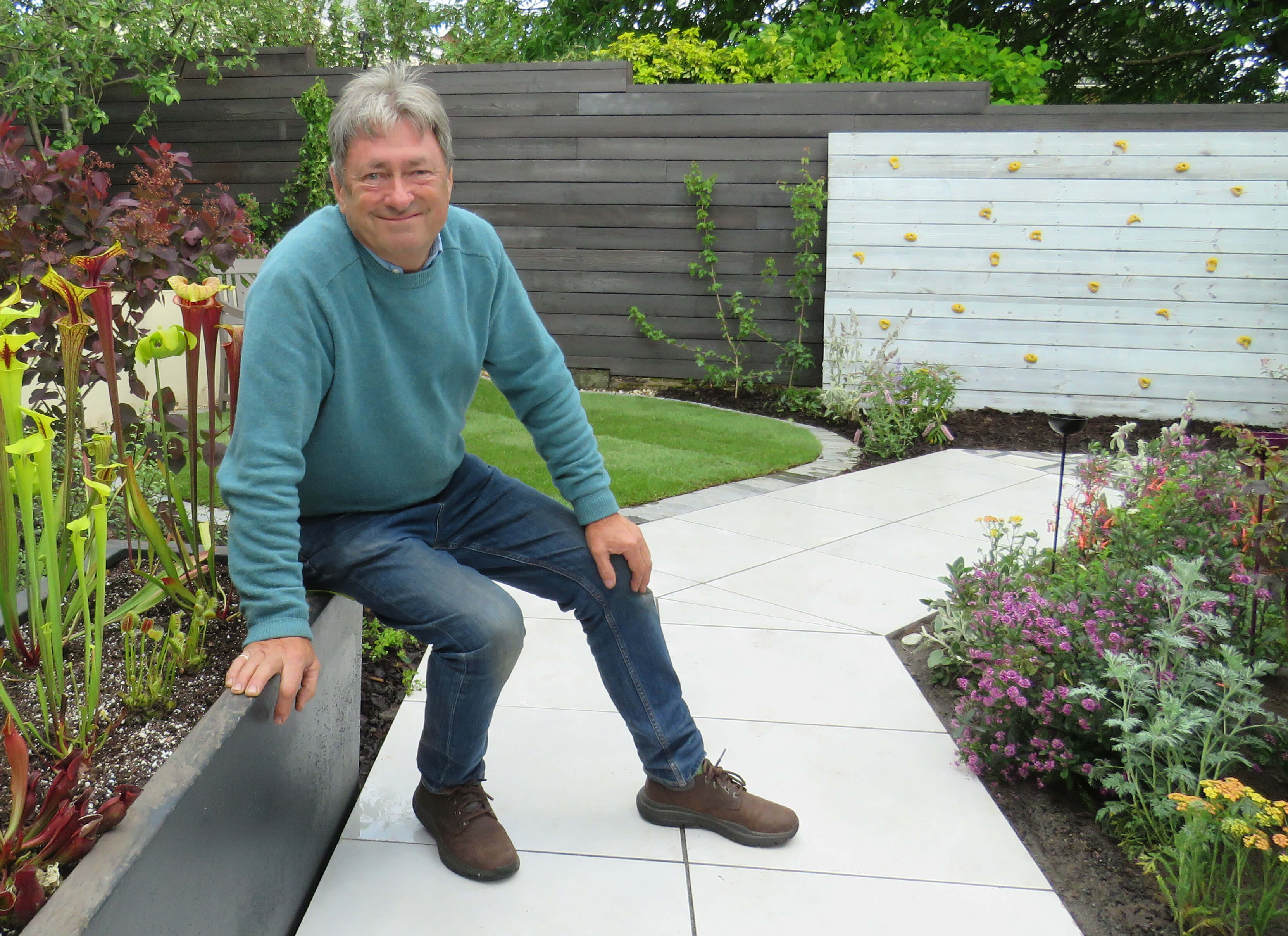alan titchmarsh sat in a garden
