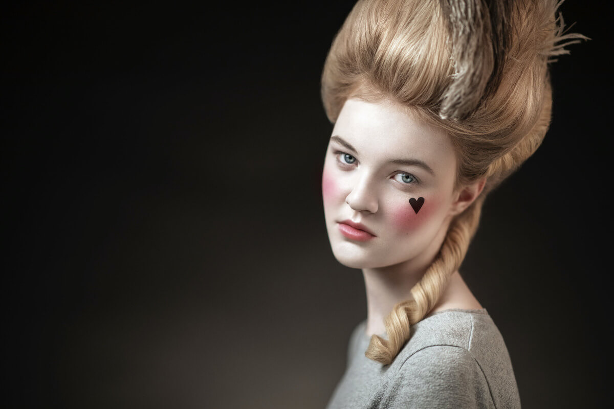 woman styled in georgian makeup