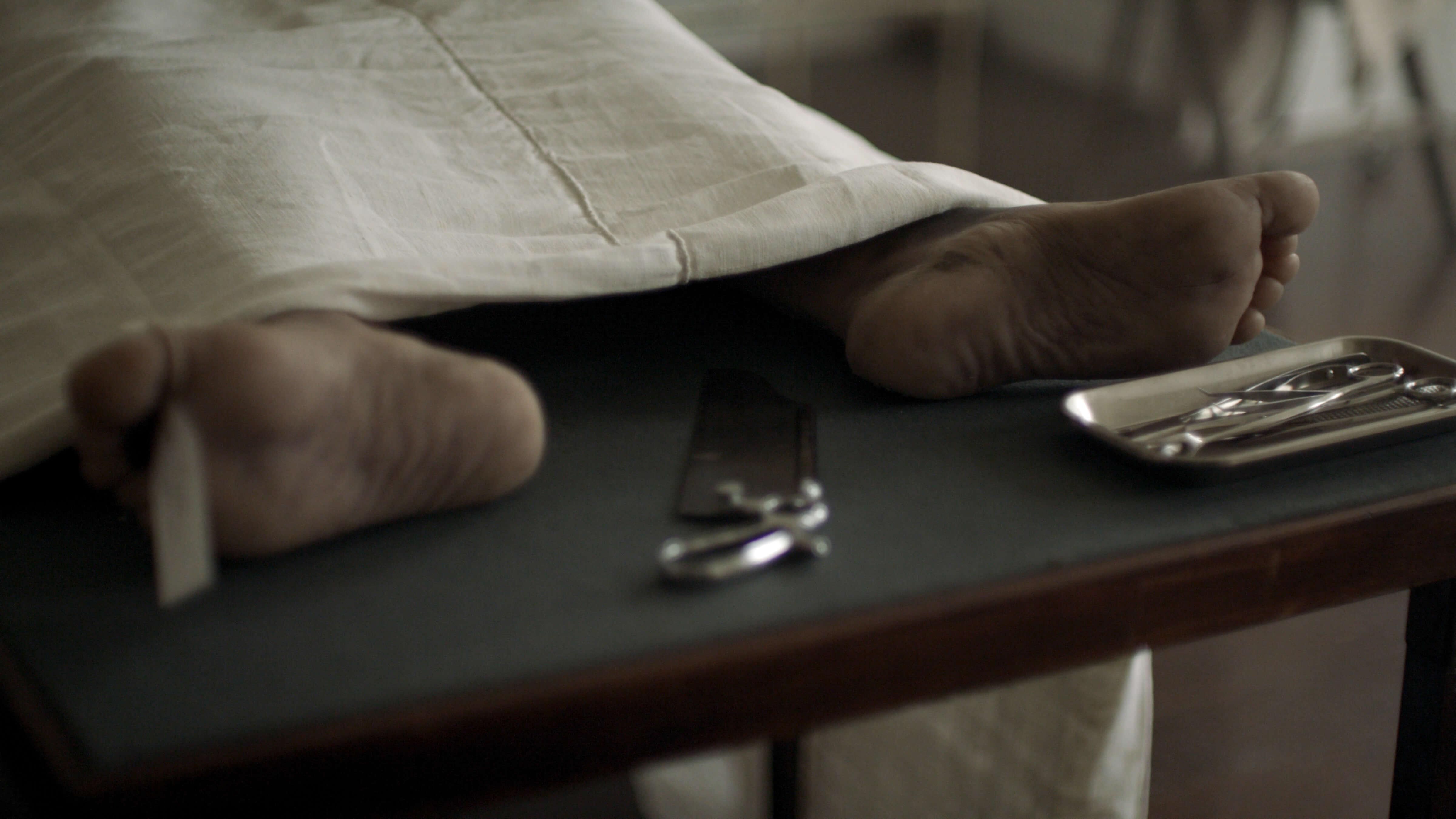feet on an autopsy table