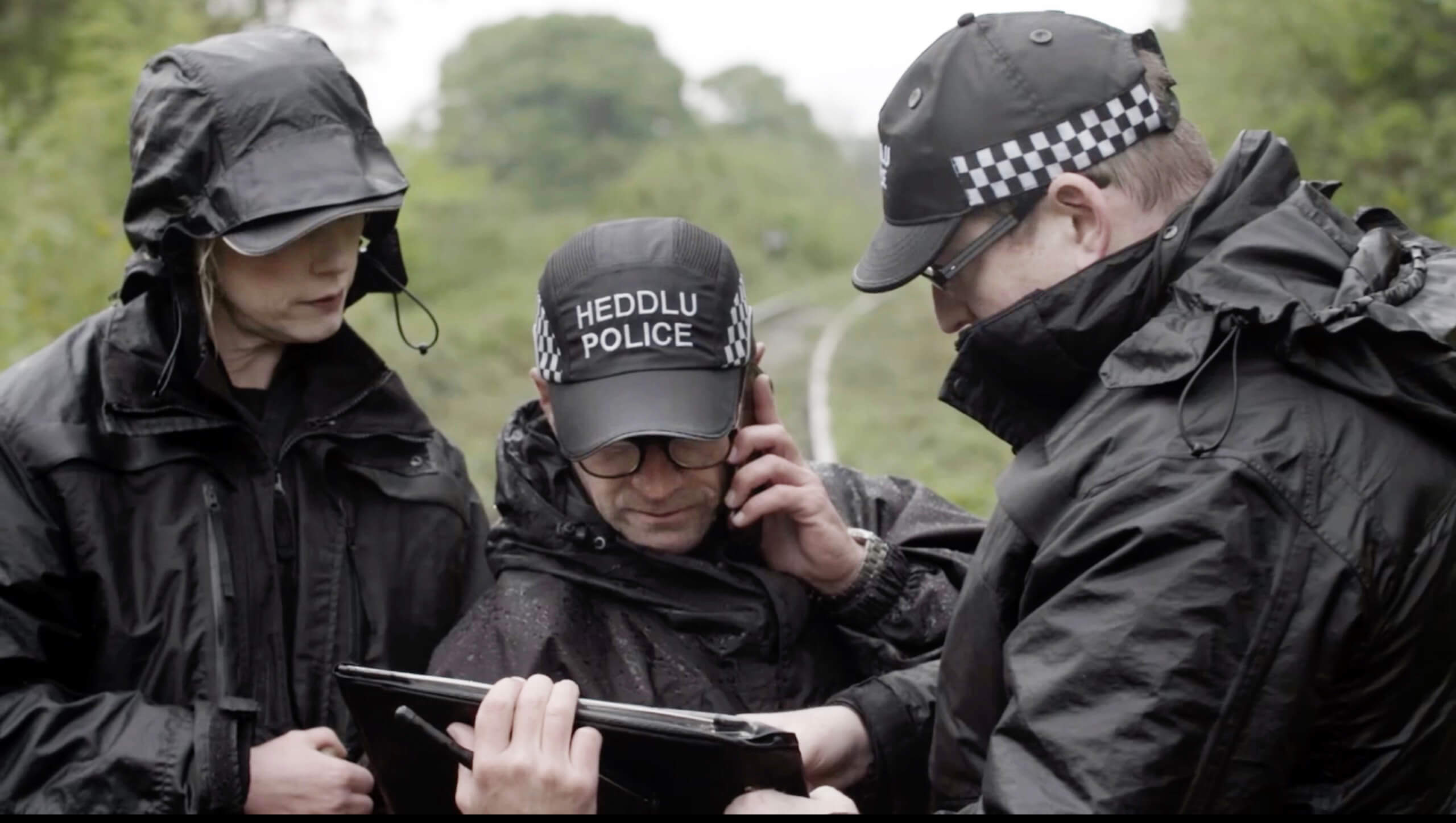 welsh police looking at map