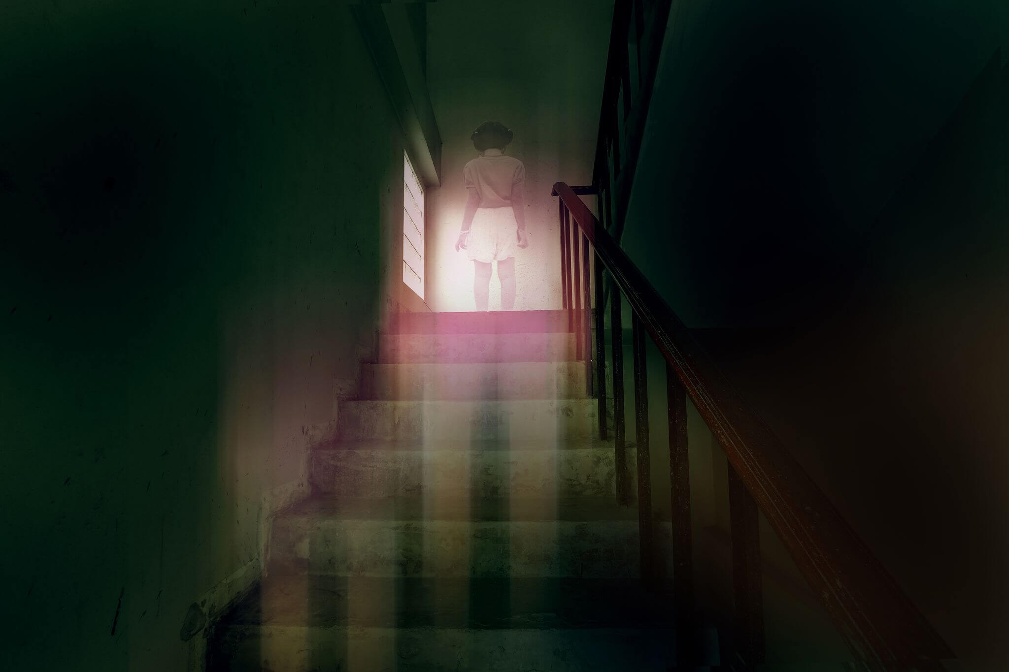 ghostly figure at the top of stairs