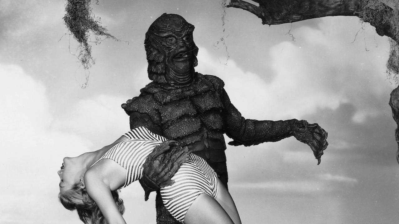 creature holding woman