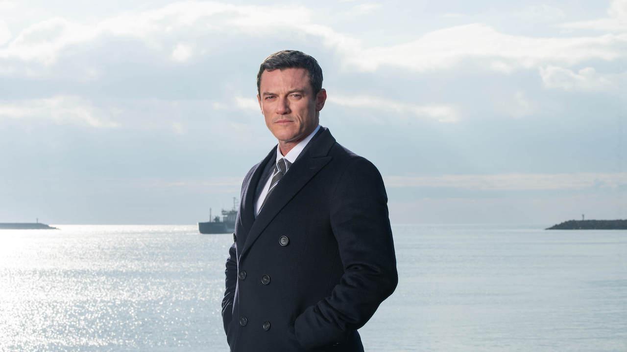 detective stood on the beach