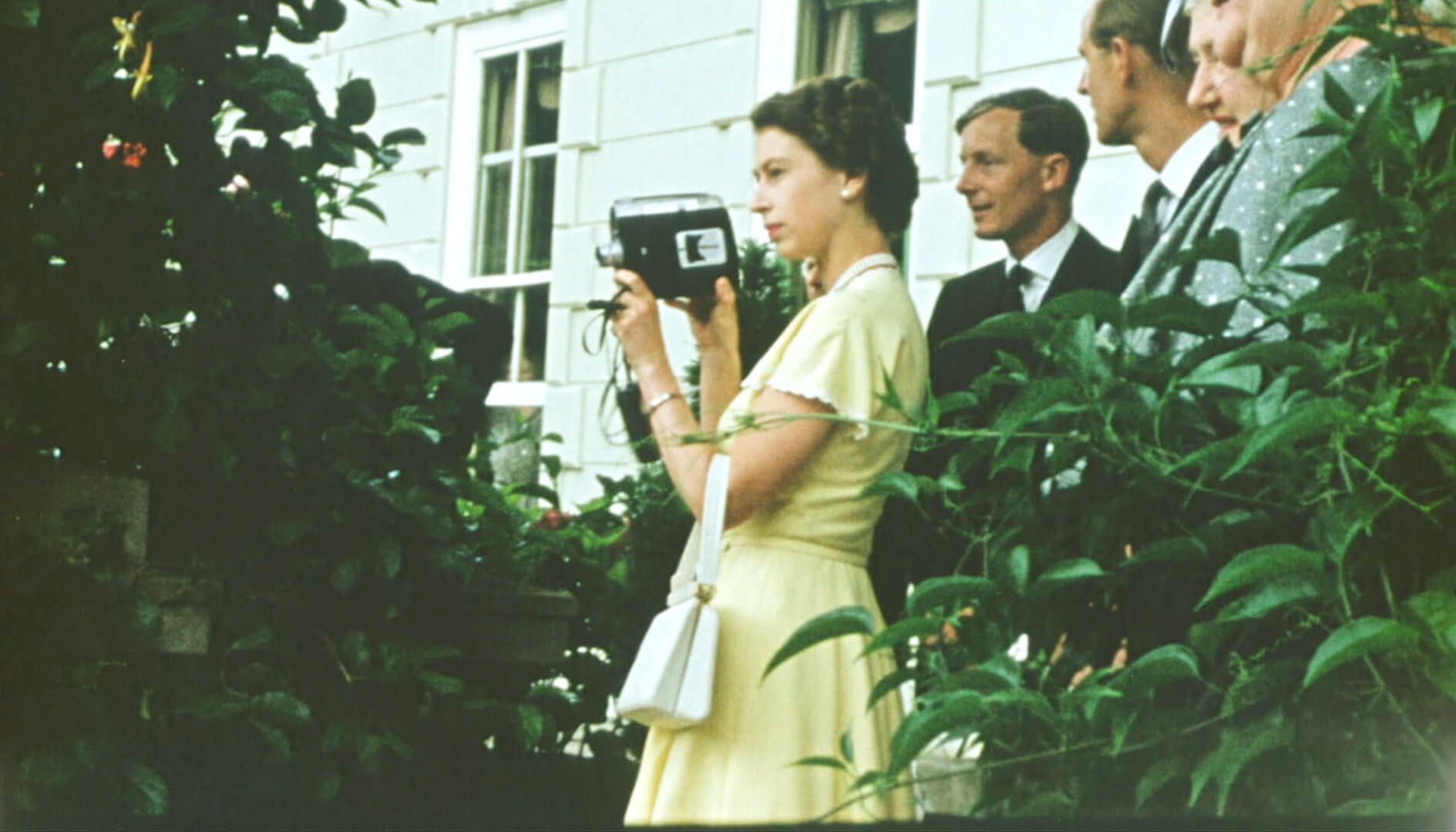 young queen elizabeth II with home camera