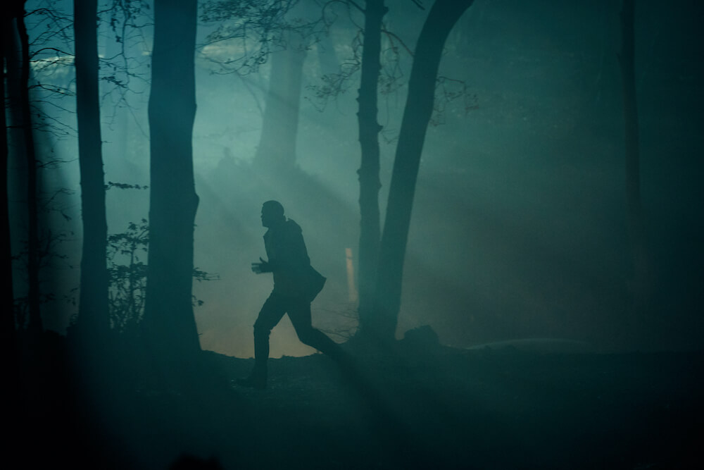 the sister shadowy figure running through the woods