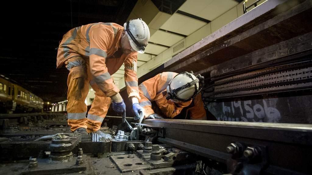rail workers on train tracks
