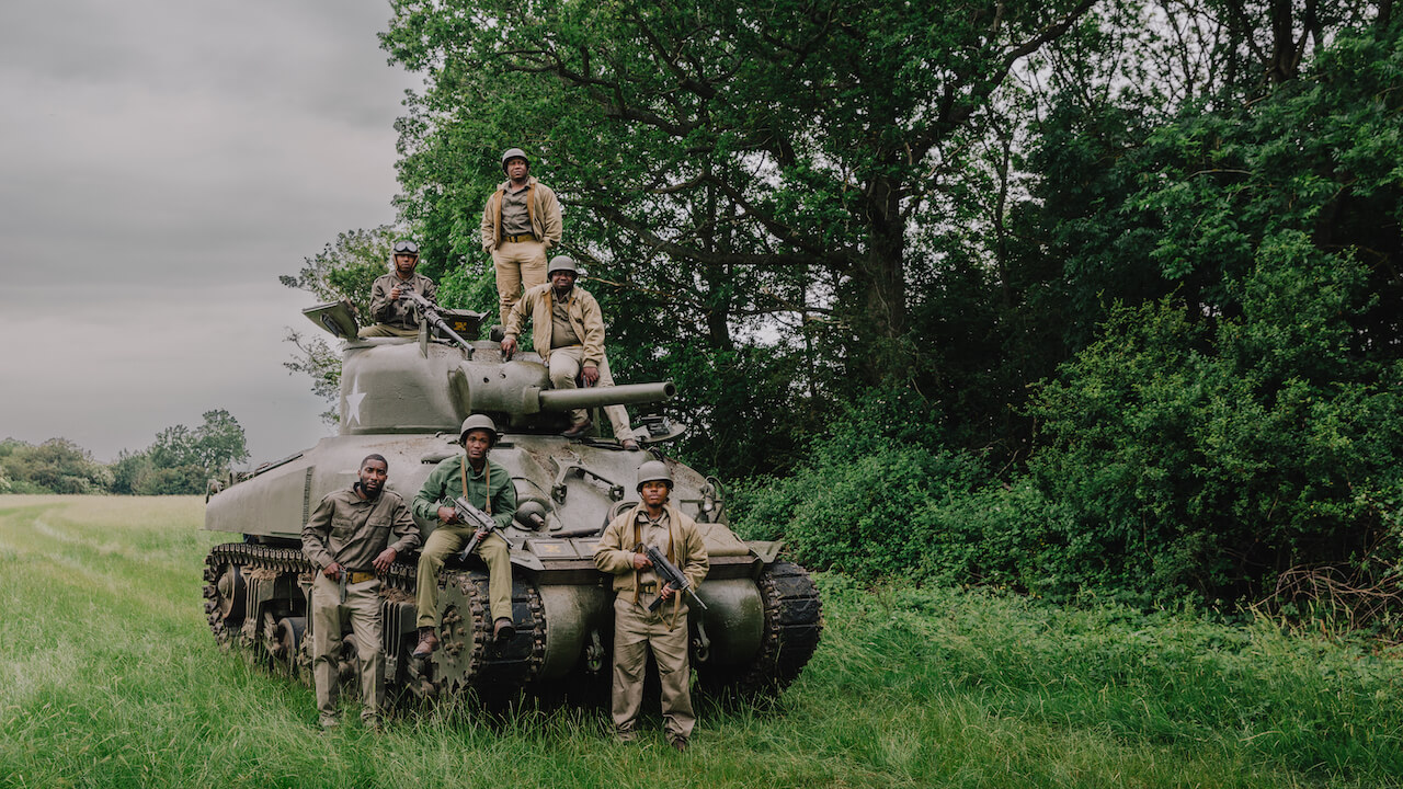 black panther soldiers by a tank