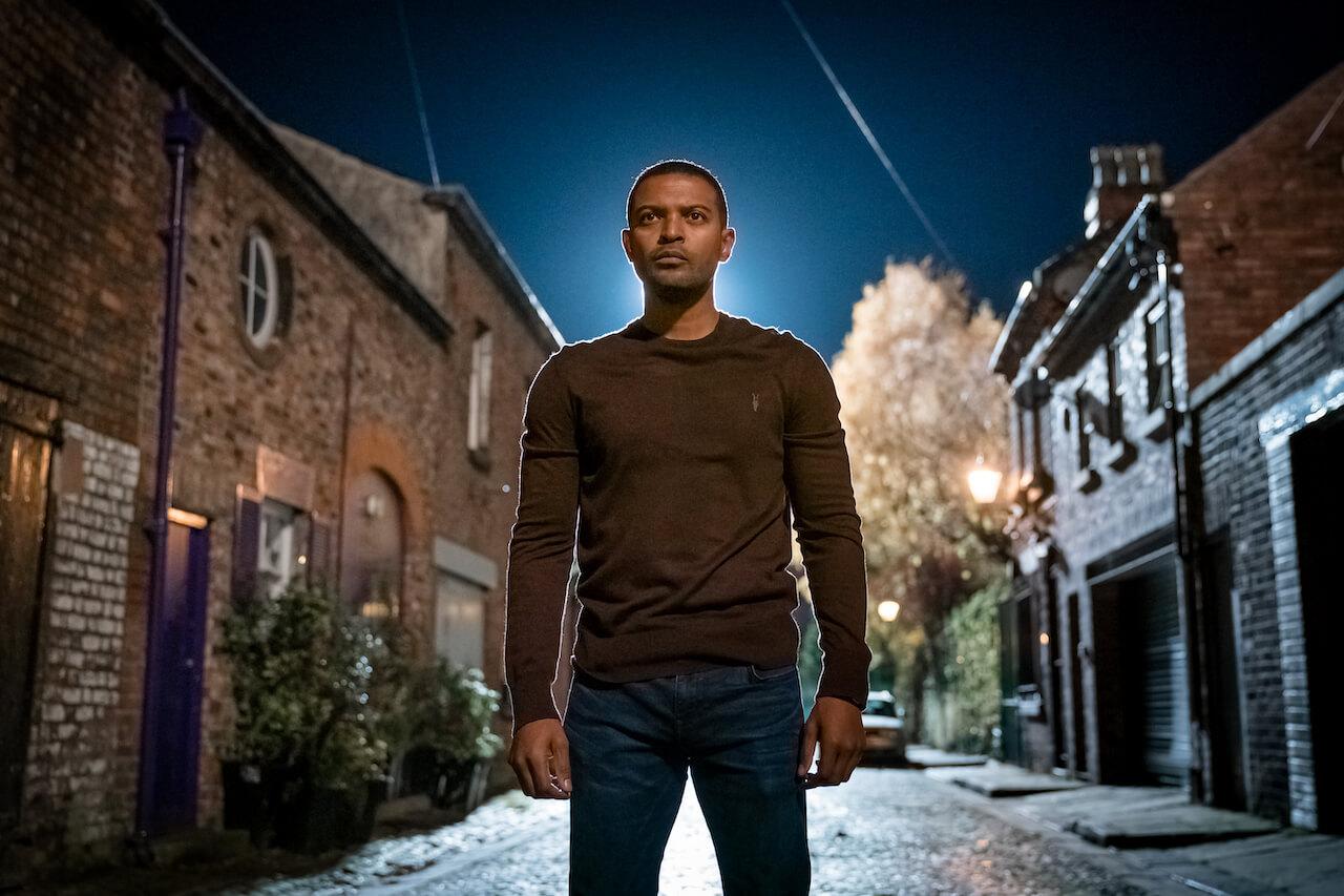 noel clarke standing on abandoned street at night