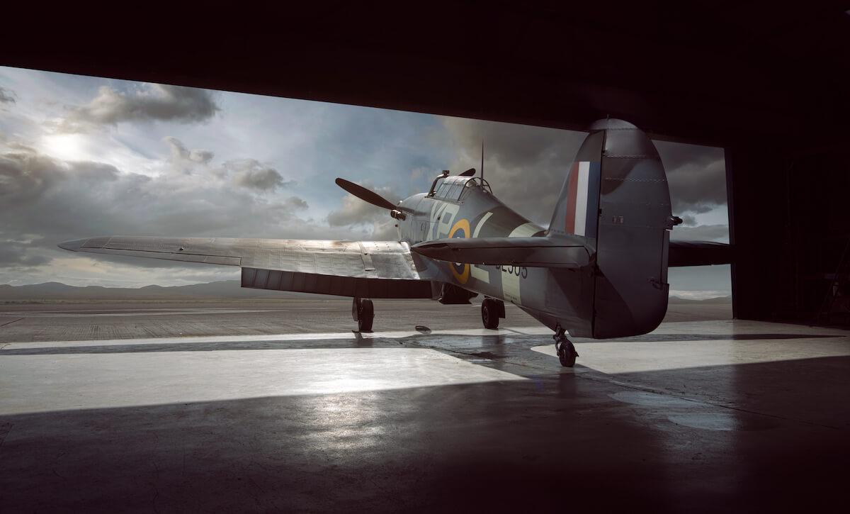 world war fighter plane leaving hanger