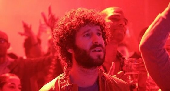 lil dicky in a club under red lights