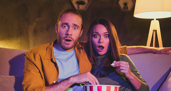shocked couple watching tv