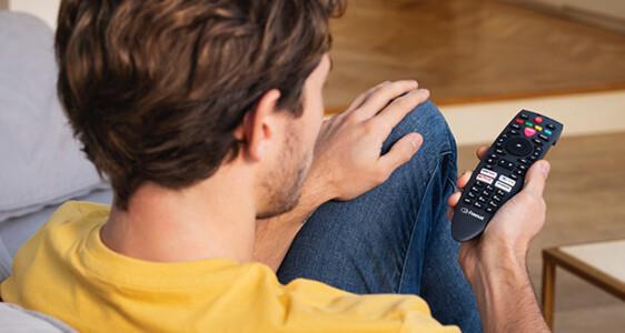 man holding freesat remote control teaser