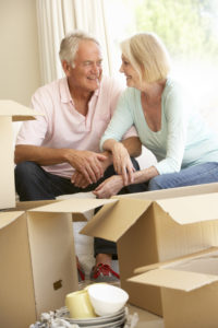 Senior couple packing and downsizing to move to a senior living community