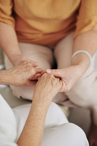 seniors hand in hand